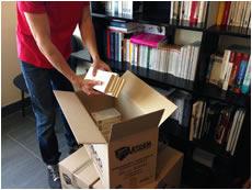 emballage et déballage de livres lors d'un déménagement